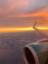 Aerial  Airplane Wing At Sunset