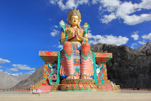 Lord Buddha Statue Against Blu...