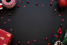 Black Festive Background With Red Decoration, Chrtistmas And New Year Greeting Card With Place For Text