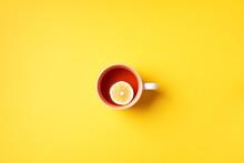 Cup Of Tea With Lemon On Yello...
