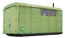 An Old Aged Green Trailer  Was...
