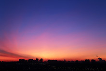 Sunrise Over The City, Scenic View. Pink-blue Sky In Soft Colors Sky Above Silhouettes Of High-rise Buildings, Colorful Cityscape For Background