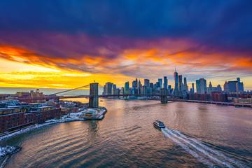 Panoramic view on Brooklyn bridge and Manhattan at sunset, New York City
