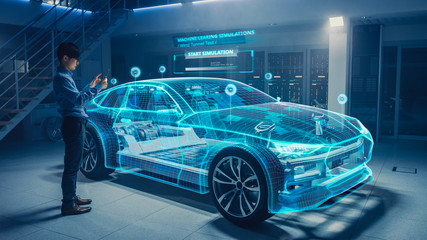 Automotive Engineer Uses Digital Tablet with Augmented Reality for Car Design...
