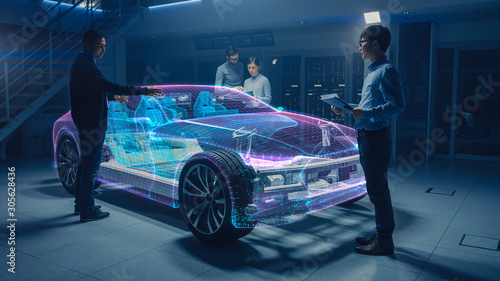 Group of Automobile Design Engineers Working on Augmented Reality 3D Model Prototype of Electric Car Chassis Canvas Print