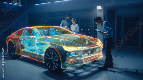 Group of Automobile Design Engineers Working in Virtual Reality 3D Model Prototype of Electric Car Chassis Canvas Print