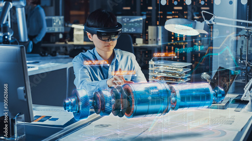 Photo Industrial Factory Chief Engineer Wearing AR Headset Designs a Prototype of an Electric Motor on the Holographic Projection Blueprint