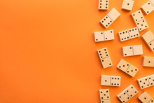 Playing Dominoes On A Orange T...