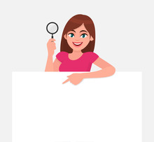 Young Woman Showing Magnifying...