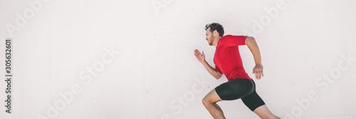 Cuadros en Lienzo Running man runner training doing city run sprinting along wall outdoor white background