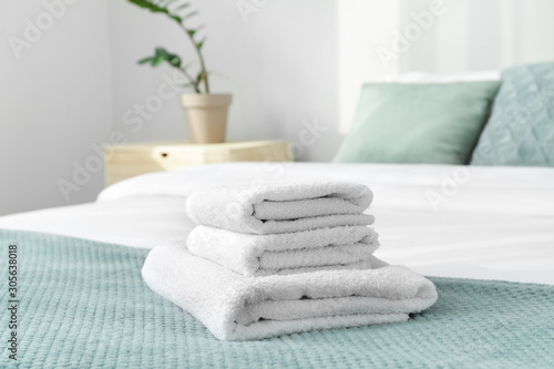 Clean soft towels on bed Wallpaper Mural