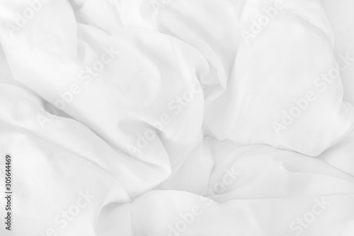 Close up top view of white bedding sheet and wrinkle messy blanket in bedroom after wake up in the morning Canvas Print