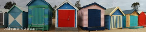 Obraz views of rows of colourful beach bright painted summer holiday bathing box's along a sandy beach on a sunny day, Brighton beach, Melbourne Victoria - fototapety do salonu