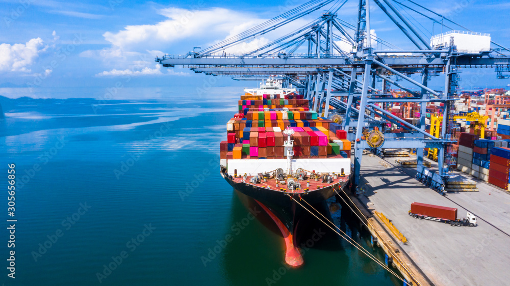 Fototapeta Container cargo ship at industrial commercial port in import export, China boat business commerce logistic and transportation of international by container cargo ship in the open sea, Aerial view.