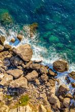 Aerial Of Ocean Waves Hitting Rocks