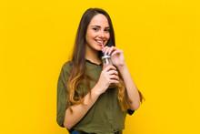 Young Pretty Woman Having A Chocolate Milkshake