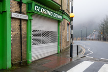 High Street Shops Closing Down With Shutters Closed, Decline In Shopping In Wales, United Kingdom