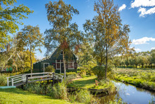 Country Wooden House Surrounded By Green Trees. Volendam Village In The Netherlands.