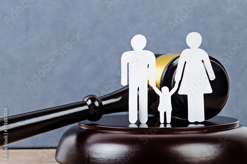 Family figure and gavel on table. Wallpaper Mural