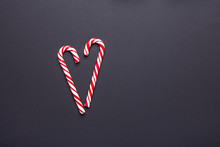 Two Candy Canes In Shape Of He...