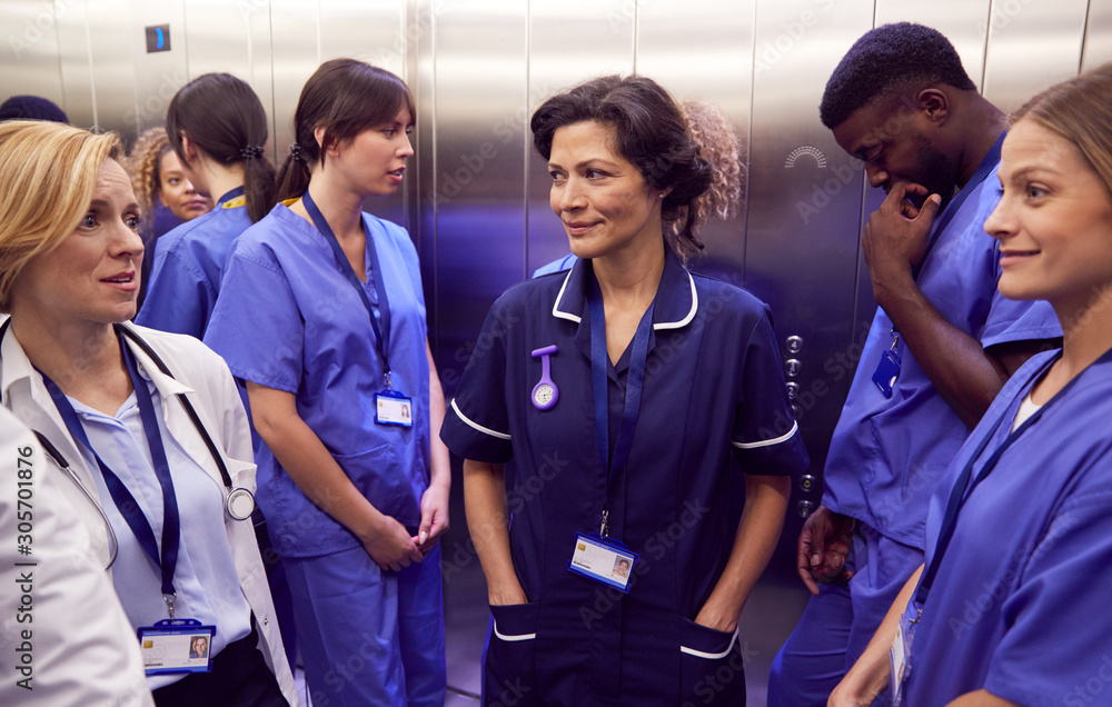 Fototapeta Medical Team In Hospital Elevator About To Perform Operation