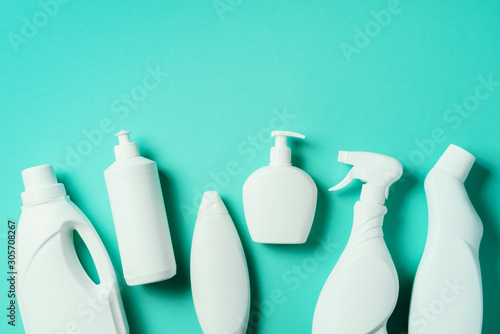 Fotografía Detergent bottles and chemical cleaning supplies on blue background