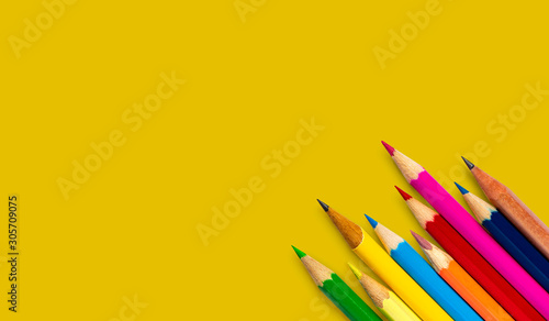 colored pencil placed on yellow paper background with copy space for your image or text Fototapete