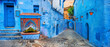 canvas print picture - Fountain with drinking water on house coloured wall in blue town Chefchaouen. Morocco, North Africa