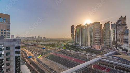 Aerial top view to Sheikh Zayed road during sunrise near Dubai Marina and JLT timelapse, Dubai Wallpaper Mural