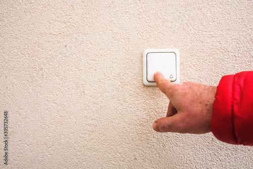 Obraz na plátně  man hand ringing on doorbell