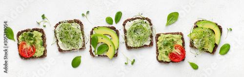 Billede på lærred Vegetarian toasts with avocado, tofu, tomato and microgreen