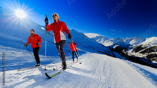 obraz PCV A family group of cross country skiers on a sunny winter morning in Italy Alps, South Tirol, Solda.