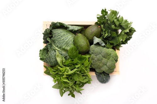 Fresh healthy vegetables in eco reusable wooden box isolated on white