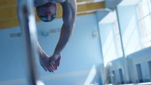 A Professional Swimmer Dives F...