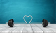 canvas print picture - 3d rendering of barbell with its bar bent in shape of heart in the middle, on wooden surface near blue wall.