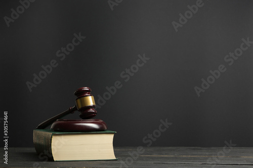 Fotomural Law concept - Open law book with a wooden judges gavel on table in a courtroom or law enforcement office isolated on white background