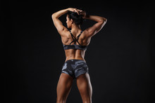 Fitness Girl With Perfect Slim And Fit Body Training Muscles With Dumbbells  Isolated. Sporty Woman Workout And Posing