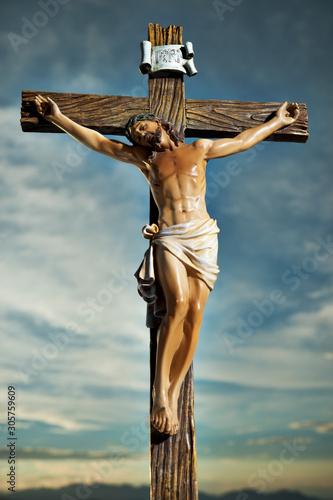 A small statue of Jesus Christ on the Cross Fototapeta