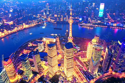 Aerial view of the Shanghai city skyline overlooking Pudong Financial District and Huangpu River at night from the Shanghai Tower Wallpaper Mural