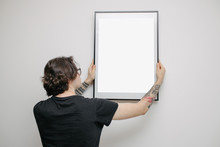 Man Hanging A Picture Or A Pos...