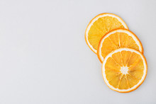 Eco Organic Homemade Dried Orange Slices, Chips. Dehydrated Crispy Fruit Slices. Heap, Pile Of Sun Dried Crunchy Oranges. Healthy Snack. Close Up. Top View. Copy Space