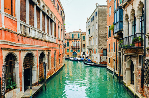 canal street with gondola in Venice - 305766226