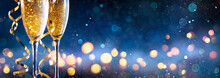 Abstract Celebration With Champagne - Flutes With Defocused Christmas Lights In Blue Shiny Background