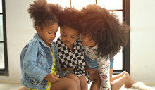 Afro Children Playing On Smart...