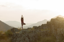 Silhouette Of Woman Doing Yoga...