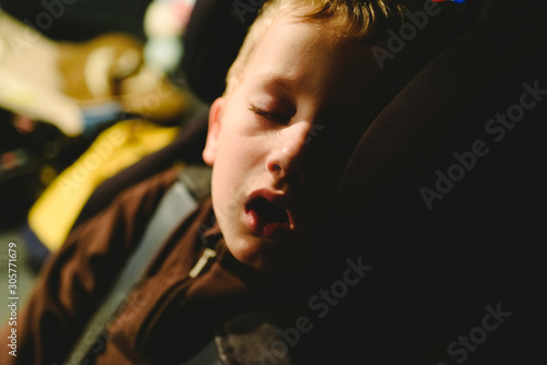 Child asleep in his extenuated car seat. Wallpaper Mural