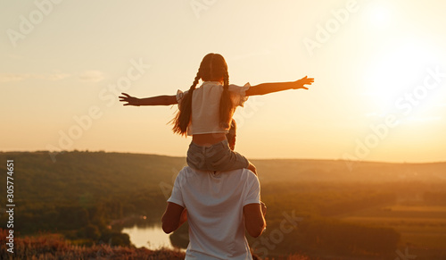 Unrecognizable father and daughter during evening in nature Wallpaper Mural
