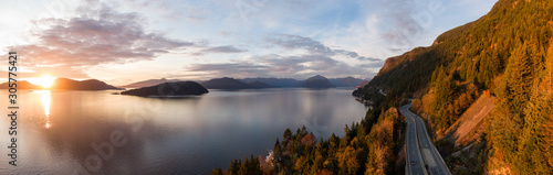 Fototapeta Sea to Sky Hwy in Howe Sound near Horseshoe Bay, West Vancouver, British Columbia, Canada. Aerial panoramic view during a colorful sunset in Fall Season. obraz
