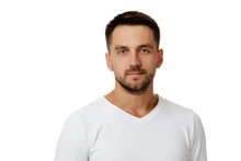 Young Handsome Bearded Man In Casual White Sweater Poses In Studio On White Background