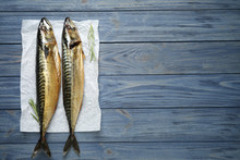 Tasty Smoked Fish On Blue Wood...